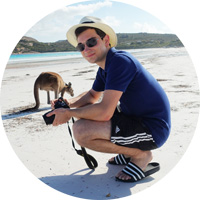 Marc with a kangaroo on the beach