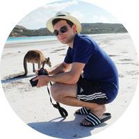 Marc with a kangaroo on the beach