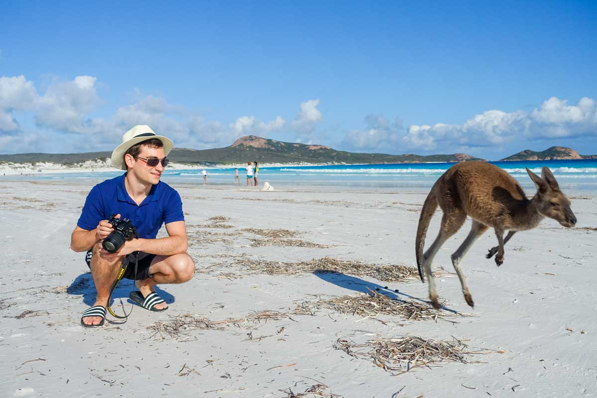 I'm next to a jumping kangaroo in Lucky Bay, WA