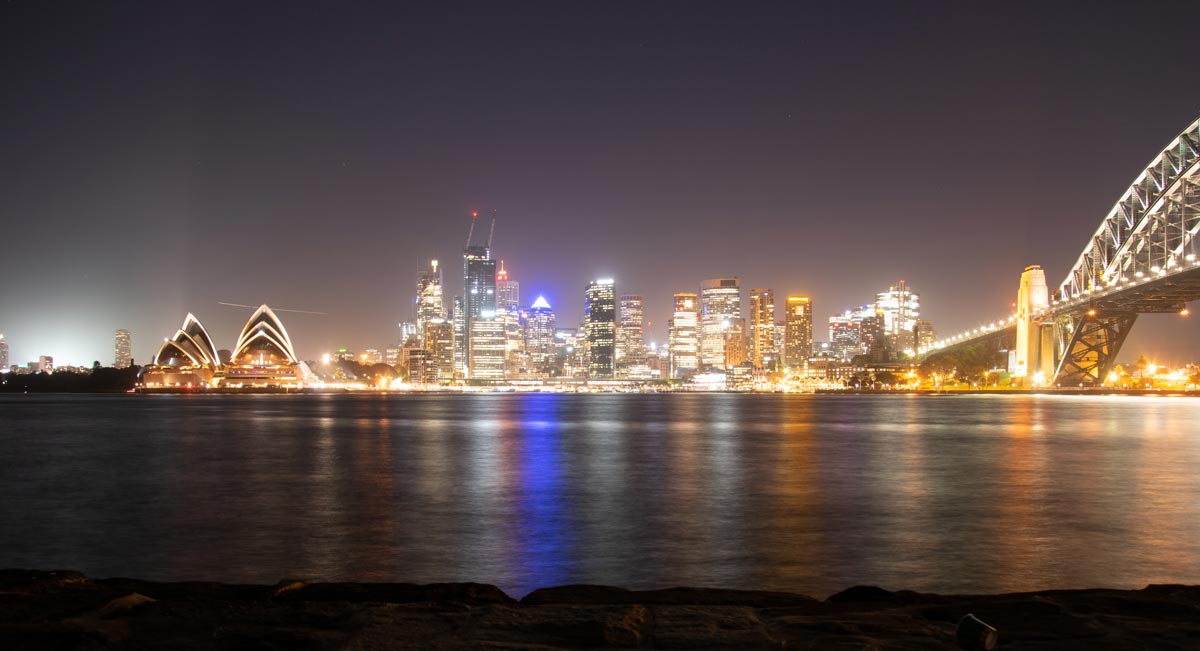 Sydney's skyline and opera house and harbour bridge at night